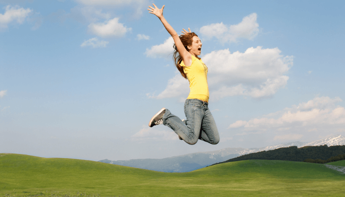A woman jumping for joy
